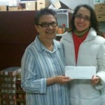 Stella from Feed My People Receives $100 gift card from Dentistry by Design