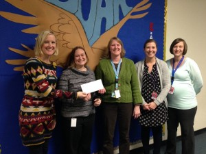 Heather LaVine presents donation to Southern Door teachers.