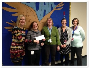Presenting a donation to Southern Door Elementary teachers.