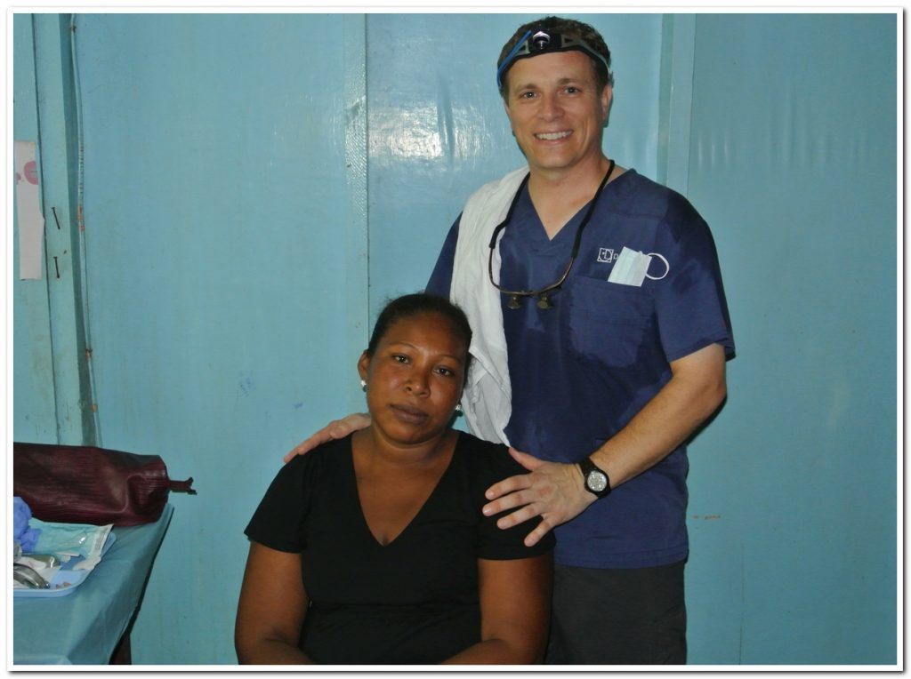 Door County Dentist Dr. Feit and a patient he worked with in Honduras