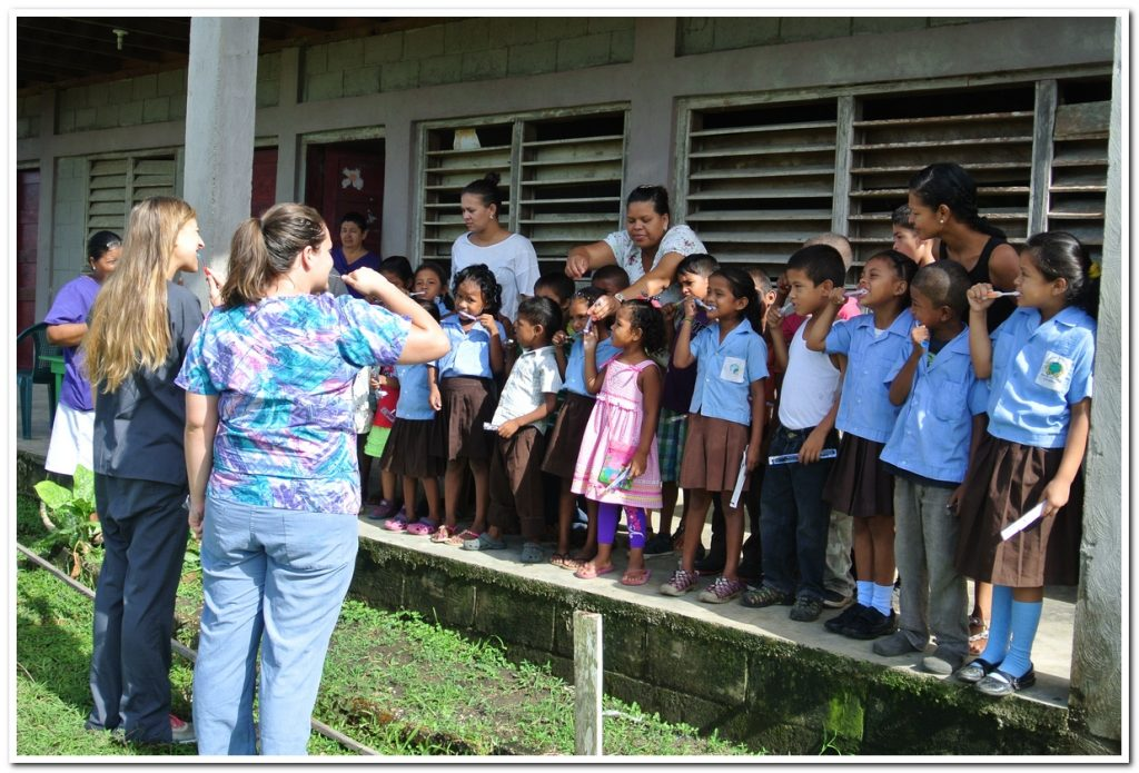 Door County Dentist Dr. Feit and team work with local Honduras Children Teaching Them Oral Hygiene